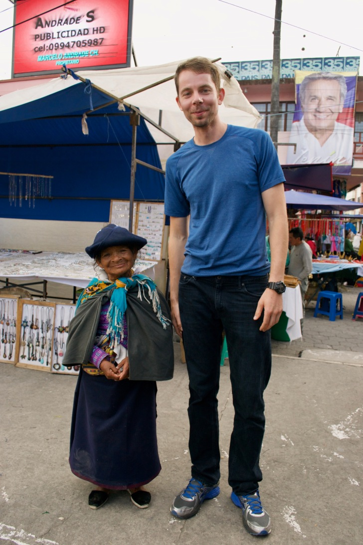 """Sasha is a giant already (6'7"""" tall), but he looked extra huge next to this adorable tiny Otavalo local woman!"""