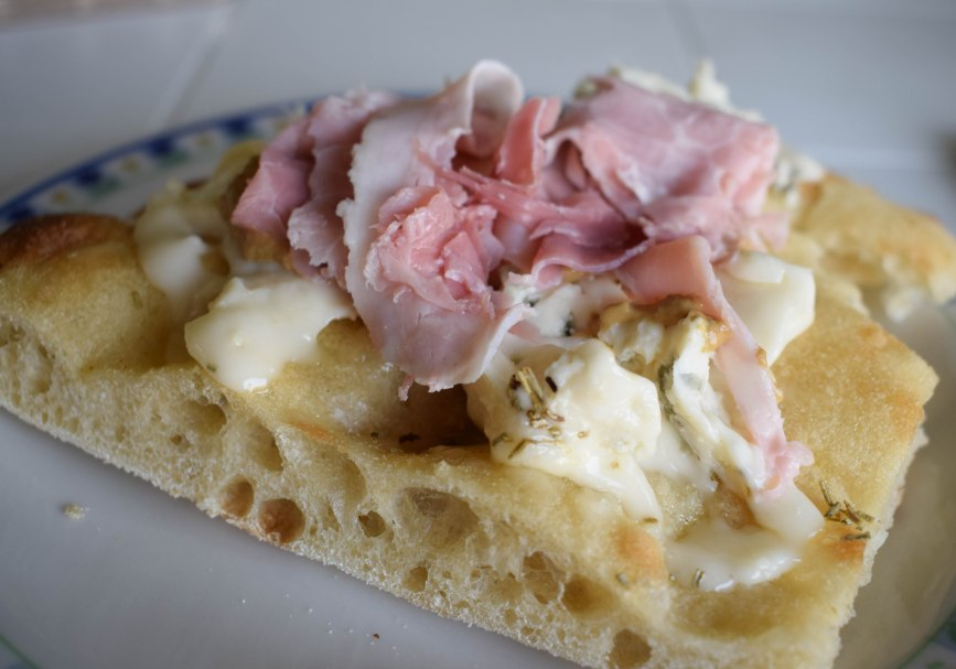 What we had for breakfast sometimes: gorgonzola dulce cheese with Parma ham melted atop toasted rosemary focaccia bread.